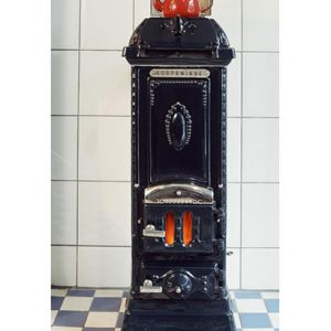 Solid fuel fully refurbished antique cast-iron with enamelled finish Nyborg stove or Ovne from Denmark.
