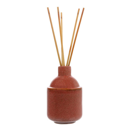 Floral scented oil diffuser in ceramic vase
