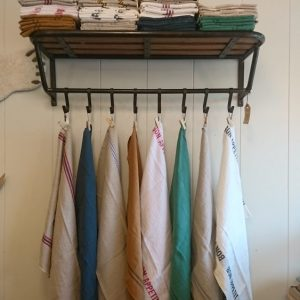 Charvet tea towels on Train luggage and coat rack with shelf, the old mill stores