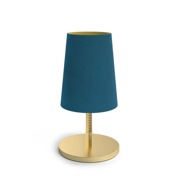 Table lamp with gold light and velvet shade